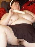 topless-plump-woman-with-massive-titties-takes-off-her-panties-and-shows-her-hairy-cunt