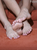 Brown haired honey with foot fetish poses naked and then has fun with her cute lesbian friend