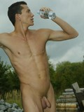 muscled-worker-takes-off-his-uniform-and-shows-his-uncut-dick-outdoors