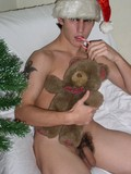 christmas-boy-in-hat-poses-with-his-teddy-bear-and-shows-his-cute-hairy-cock