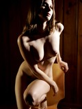 nude-brunette-poser-displays-her-beautiful-body-in-the-semi-dark-showing-it-all