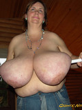 plump-topless-lady-in-blue-jeans-plays-with-her-unbelievably-big-knockers