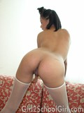 pigtailed-asian-takes-off-her-uniform-and-shows-her-pink-hole-with-her-stockings-on