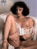 dark-haired-lady-with-retro-hair-style-and-slim-legs-rubs-her-bush-tenderly