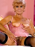 naughty-granny-in-black-stockings-and-pink-corset-spreads-her-hairy-mature-pussy