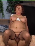 breasty-granny-in-white-bra-and-black-stockings-gets-fucked-by-hot-young-stud