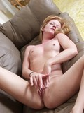 completely-nude-blonde-plays-with-her-shaved-pink-pussy-on-a-leather-sofa-and-gets-orgasm
