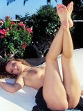curly-beauty-spreads-her-fine-slim-legs-by-the-pool-and-shows-her-hairy-snatch