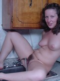 nude-amateur-brunette-masturbates-her-hairy-pussy-with-faucet-and-water-in-the-kitchen