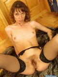 brown-eyed-chick-in-black-stockings-and-boots-exposes-her-hairy-snatch
