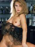fashionable-slim-blonde-in-elegant-black-dress-shows-her-small-nipples-and-bushy-pussy