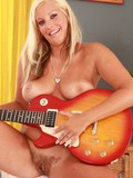 breasty-blonde-strips-naked-and-takes-dark-thick-cock-in-her-hairy-pussy