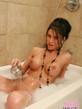 lovely-brunette-showers-her-perfect-round-tits-and-shows-off-her-tight-foamy-ass