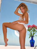 long-haired-seductress-in-short-white-dress-shows-off-her-long-legs-and-cute-pussy