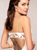 charming-celebrity-angelina-jolie-in-beautiful-dress-shows-her-tattooed-back