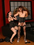 pierced-man-in-corset-and-stockings-gets-whipped-by-sexy-long-legged-mistress