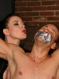 perfectly-sculptured-naked-man-gets-punished-by-latex-loving-dominatrix-behind-the-bars