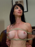 round-boobed-brunette-in-latex-boots-gets-hogtied-then-master-vibrates-her-shaved-pink-cunt