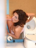 horny-brunette-strokes-her-needy-shaved-pussy-like-crazy-in-the-public-toilet