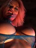 fetish-blonde-with-fire-in-her-eyes-shows-her-hairless-crotch-and-massive-melons-in-the-dark