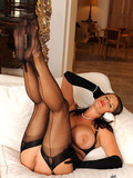 bosomy-doll-in-black-stockings-and-high-heeled-shoes-is-able-to-make-hot-footjob