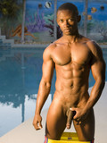 slim-black-muscle-dude-takes-off-his-yellow-shorts-and-shows-his-long-dick-by-the-pool
