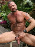hairy-chested-strong-aged-man-gets-nude-outdoors-and-gives-a-close-up-of-his-dick