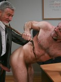 Mature gay man in office uniform fucks sexy ass of nude bearded buddy