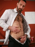 Bearded elegant mature man in office uniform bares her hairy chest, firm ass and hard cock