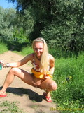 sweet-blonde-girl-spreads-her-legs-and-pisses-in-the-middle-of-the-country-road