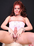middle-aged-redhead-tranny-with-juicy-tits-decides-to-show-you-her-penis