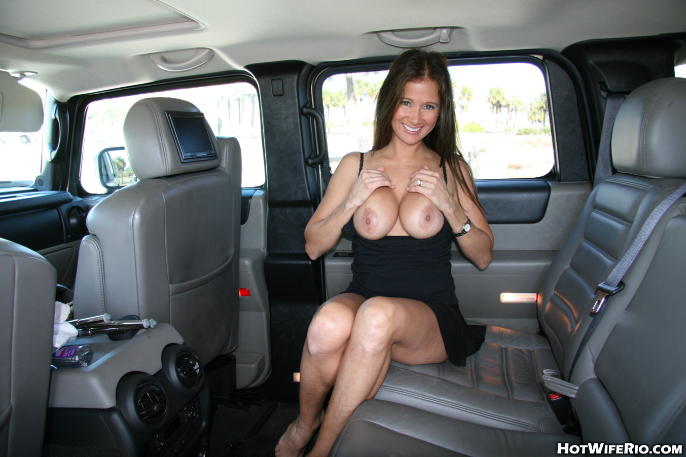 naughty brunette wife in black dress shows off her big tits and neat
