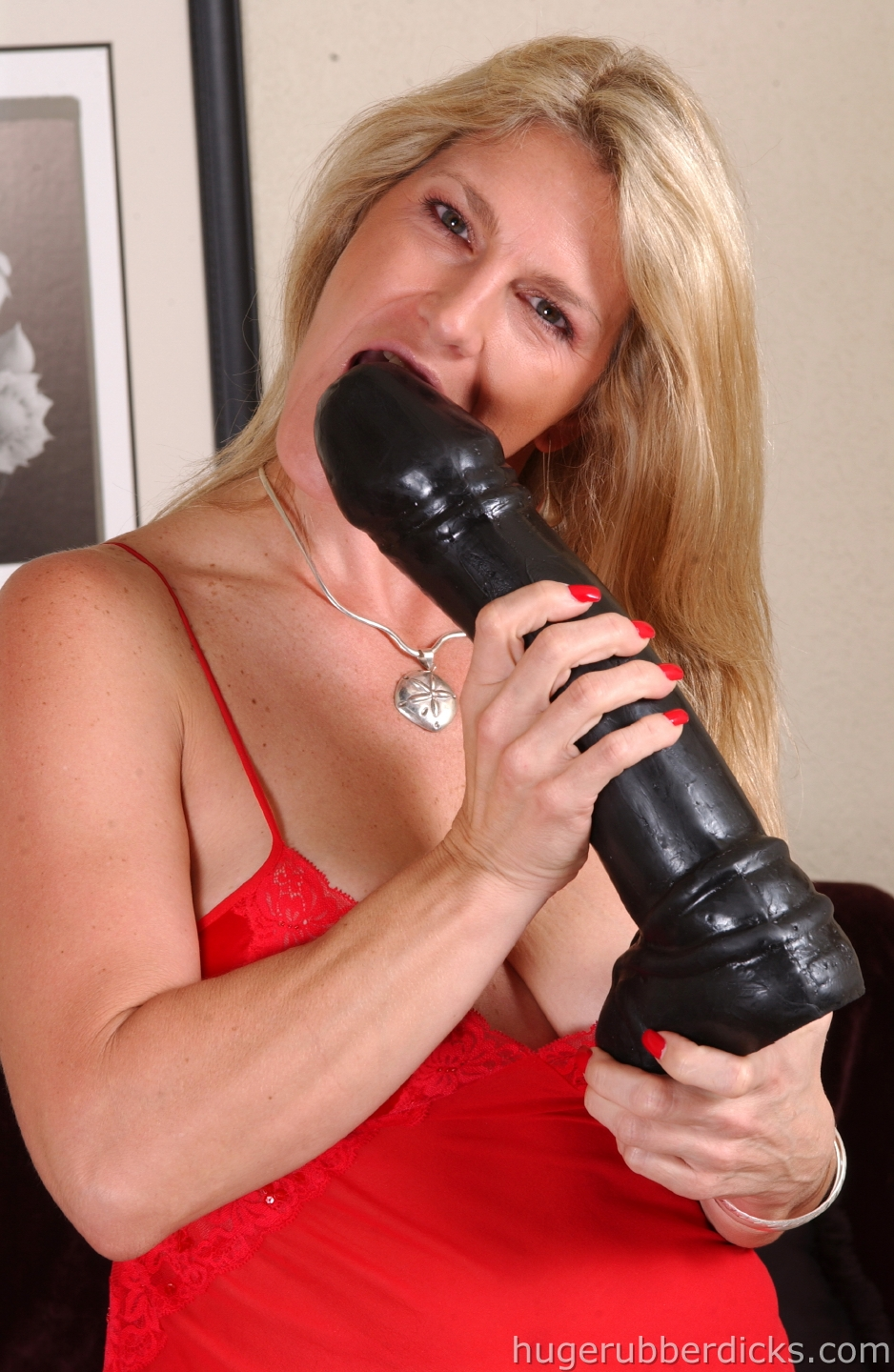 blonde mom in sheer nylons inserts big black dildo in her capacious