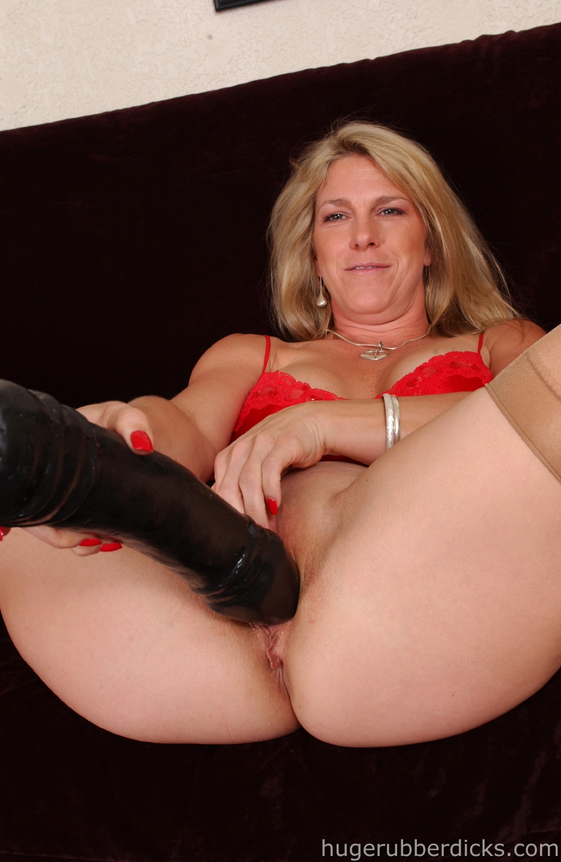 blonde mom in sheer nylons inserts big black dildo in her capacious