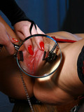 helpless-slave-girl-gives-a-close-up-view-of-her-clamped-pussy-lips-in-this-femdom-gallery