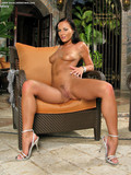 naked-leggy-brunette-in-high-heels-shows-off-her-adorable-ass-and-hairless-crotch