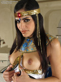 Long legged egyptian beauty with pierced nipples spreads her smooth pussy open