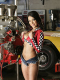 long-legged-brunette-with-tiny-tight-jean-shorts-shows-her-tits-in-the-garage