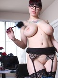 four-eyed-secretary-strips-and-shows-her-giant-tits-during-the-coffee-break