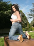 playful-brunette-chick-in-blue-jeans-flashes-her-white-panties-in-the-open-air