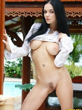 raven-haired-young-model-shows-off-her-big-melons-and-neatly-trimmed-bush