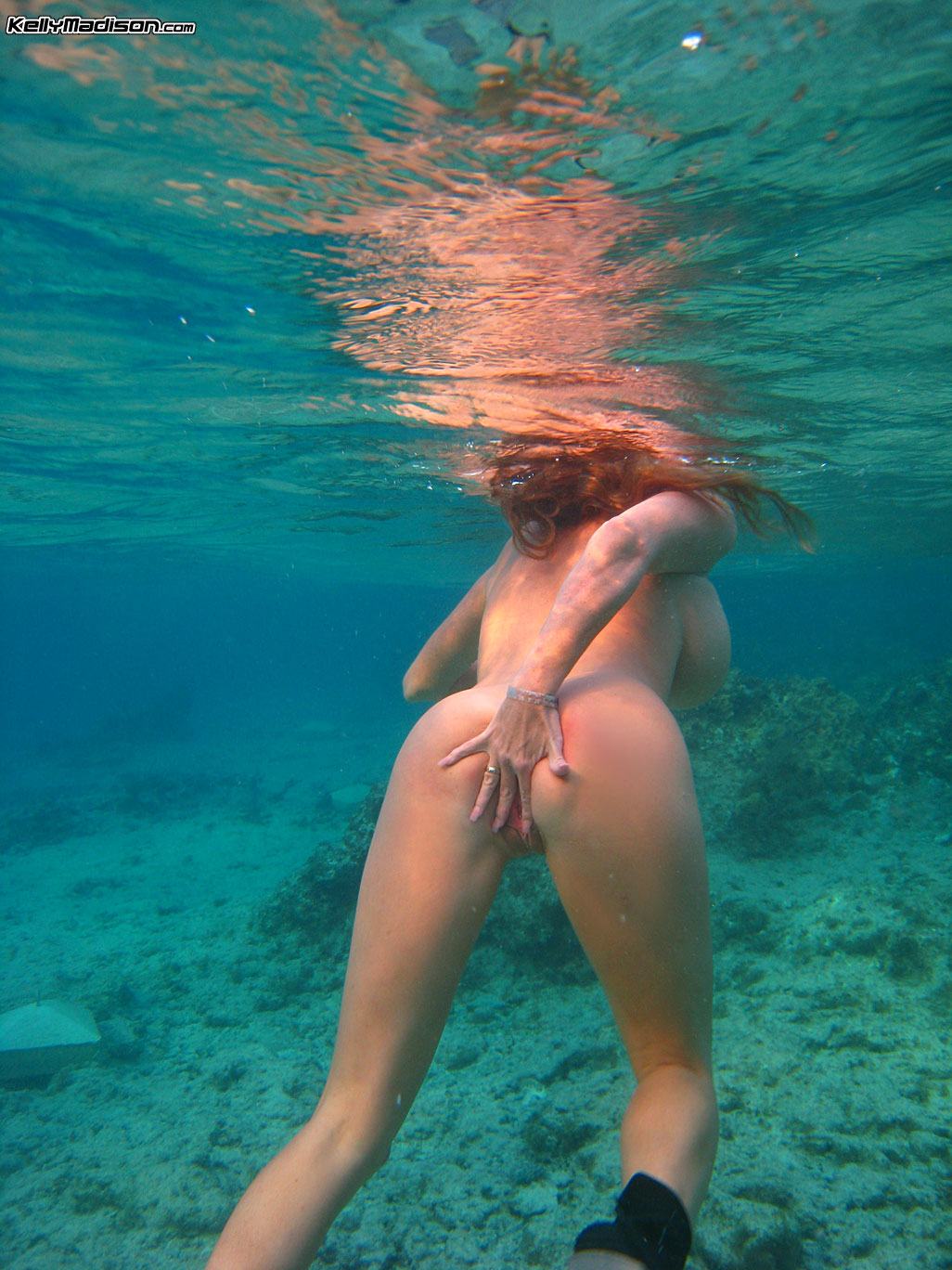 Naked girls with big boobs under water
