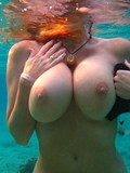 playful-pornstar-kelly-madison-shows-her-giant-melons-and-shaved-snatch-under-water
