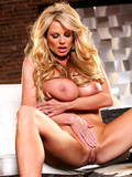 huge-boobed-blonde-sexbomb-kelly-madison-strips-naked-and-parts-her-legs