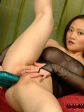 gorgeous-asian-in-high-heels-and-transparent-fishnet-suit-plays-with-flexible-dildo