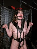 pony-girl-with-chain-clamps-on-her-small-nipples-gets-a-heavy-metal-collar