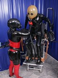 dominated-man-in-black-airtight-rubber-suit-gets-his-ass-drilled-with-strapon