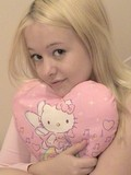 blonde-teen-in-white-and-pink-underwear-shows-her-juicy-melons-and-bald-snatch
