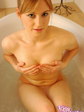 cutie-in-orange-panties-takes-off-her-revealing-white-top-in-the-bathtub