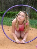 barely-legal-smiling-teen-sweetie-kitty-karsen-plays-with-hula-hoop-outdoors